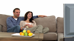 Couple watching television with popcorn Footage