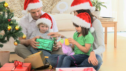 Lovely family opening Christmas gifts Footage