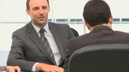 Businessman talking with colleagues during a meeti Footage