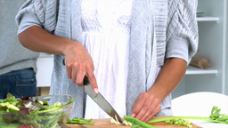 Woman concentrating on preparing food Stock Video Footage