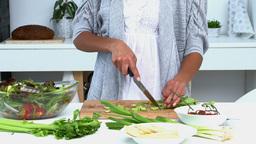 Beautiful woman cooking vegetables Footage