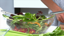 Beautiful woman preparing a salad for lunch Stock Video Footage
