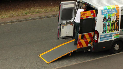 Paramedic talking to someone in ambulance Stock Video Footage