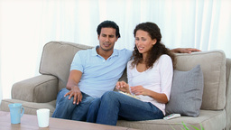 Couple being scared by a movie on the television Footage