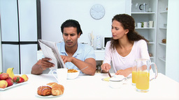 Man reading newspaper while having breakfast with Stock Video Footage