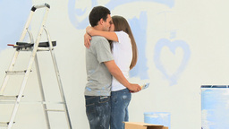 Man kissing and hugging his girlgriend during a re Footage