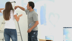 Cute couple renovating a room Stock Video Footage