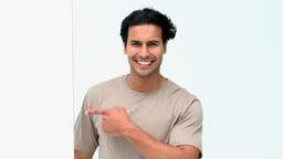 Smiling man pointing at a white board Footage