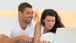 Smiling couple using laptop Stock Video Footage