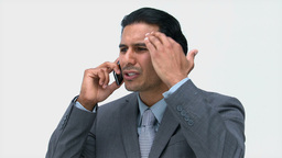 Serious businessman talking on the phone Footage
