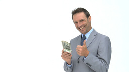 Happy businessman holding dollars Footage