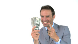 Smiling man holding dollars Stock Video Footage