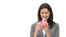 Smiling businesswoman saving money in a piggy bank Footage