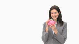 Businesswoman saving money in a piggy bank Footage