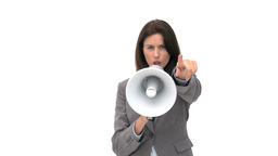 Beautiful businesswoman shouting through megaphone Stock Video Footage