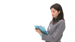 Businessman writting on her notebook Footage