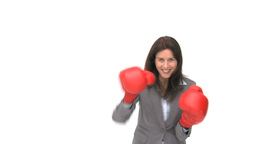 Smiling businesswoman with boxing gloves Footage