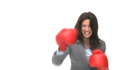 Angry businesswoman with boxing gloves Footage