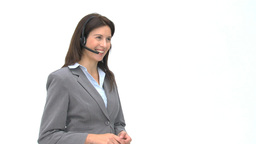 Happy businesswoman talking with headphones Footage