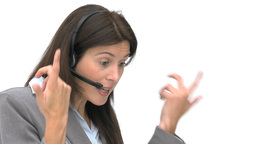 Angry businesswoman talking with headphones Footage