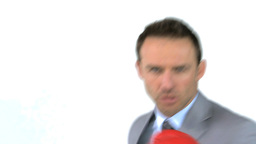 Angry businessman with boxing gloves Footage