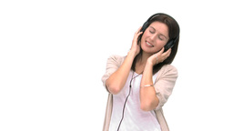 Woman smiling at the camera while shes listening t Stock Video Footage