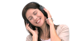 Closeup of a woman listening to music Footage