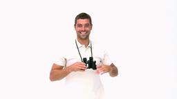 Happy man looking through binoculars Stock Video Footage