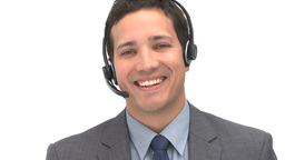 Smiling man talking with headphones Footage