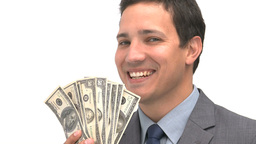 Smiling man pointing dollars Footage