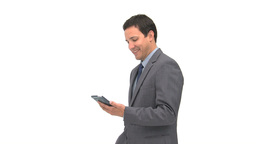 Smiling businessman using a computer tablet Footage