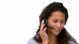 Joyful businesswoman talking with headphones Footage