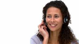 Joyful businesswoman talking with headphones Stock Video Footage