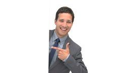 Happy businessman pointing a white board and smili Stock Video Footage