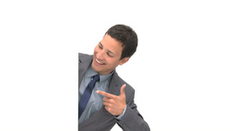 Smiling businessman pointing a white board Stock Video Footage