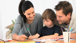 Parents Drawing With Their Son stock footage