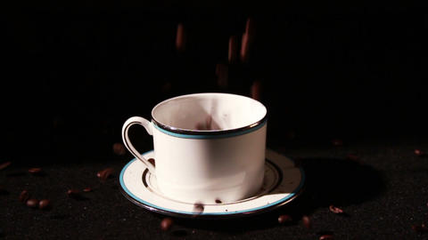 1574 Coffee Beans Falling into Cup in Slow Motion Stock Video Footage