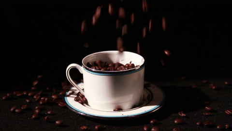 1574 Coffee Beans Falling into Cup in Slow Motion Footage