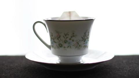1590 Tea Bag Going Into Tea Cup stock footage