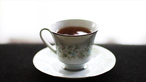 1595 Tea Drops in Tea Cup, Slow Motion Stock Video Footage