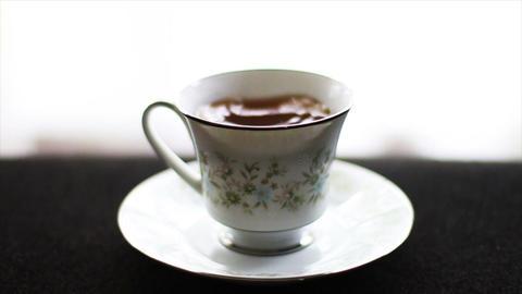1595 Tea Drops in Tea Cup, Slow Motion Footage