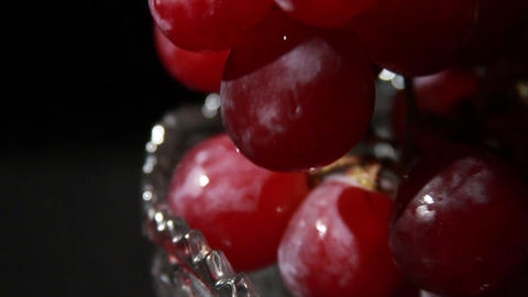 1504 Grapes being Picked Up in Glass Bowl Footage