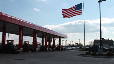 American Flag next to Gas Station, Slow Motion Footage