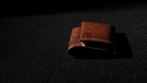 1376 Leather Wallet Being Thrown Down, Slow Motion Footage