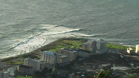 1427 Sunset Ocean Waves and High Rises in Cape Tow Footage