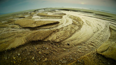 Low tide fish eye view of the beach, sunset Footage