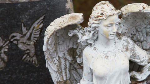 1111 Stone Angel Next to Grave Stone Stock Video Footage