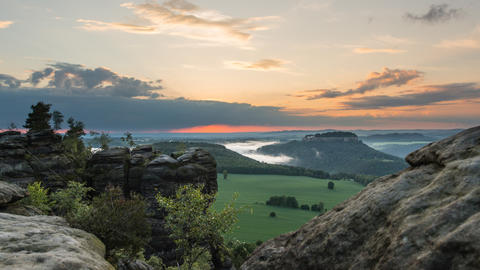 4k UHD sunset and fog saxon swiss mountain 11441 Stock Video Footage
