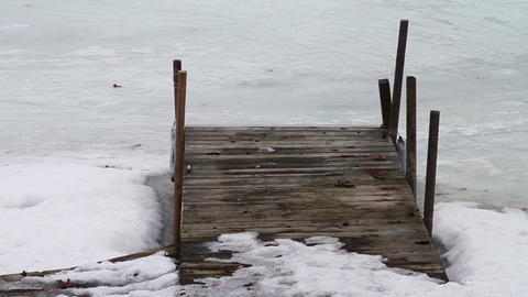 1122 Frozen Lake During Winter by Wooden Dock Stock Video Footage