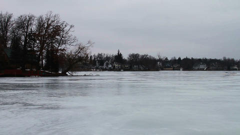 1123 Frozen Lake During Winter Next to Houses Footage